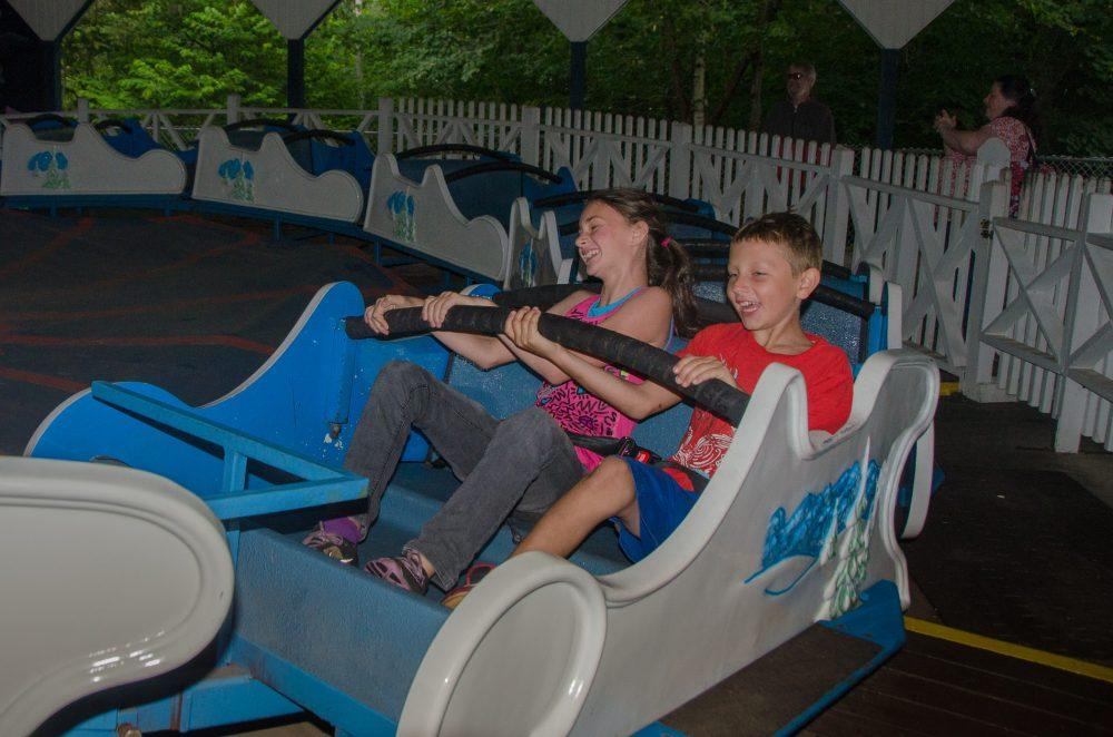 two children riding the himalaya circular ride